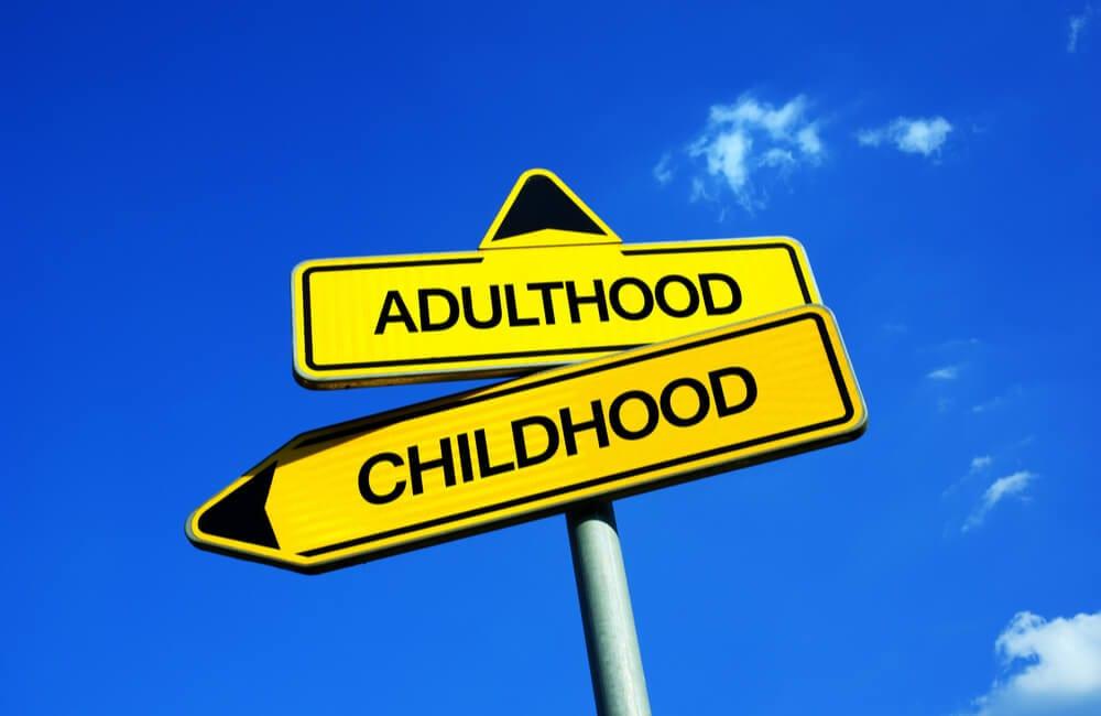 Adulthood vs. Childhood ©M-SUR / Shutterstock.com